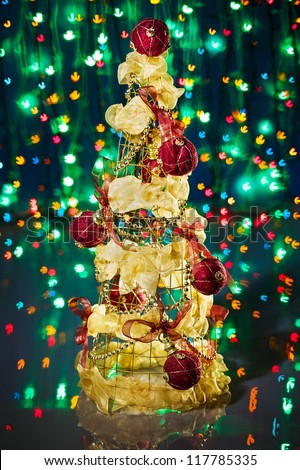 Christmas tree decorated on green sparkling background