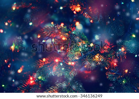 Christmas tree decorated with garlands, close-up