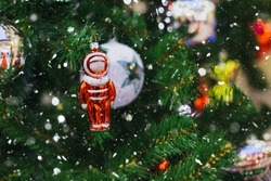 Christmas tree decorated with Soviet Christmas decorations, red cosmonaut, retro toy from the USSR, place for text