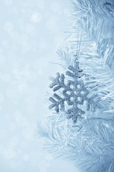 Christmas tree decoration snowflake. Vertical card.