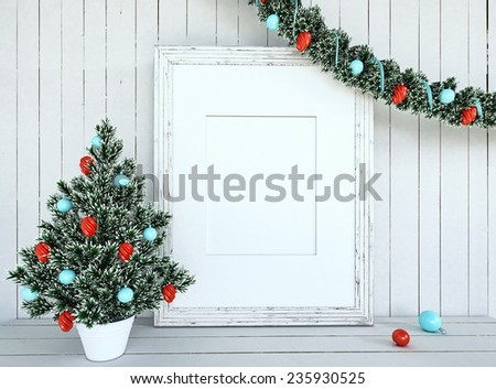 Christmas Tree Decoration with empty frame on white wood background