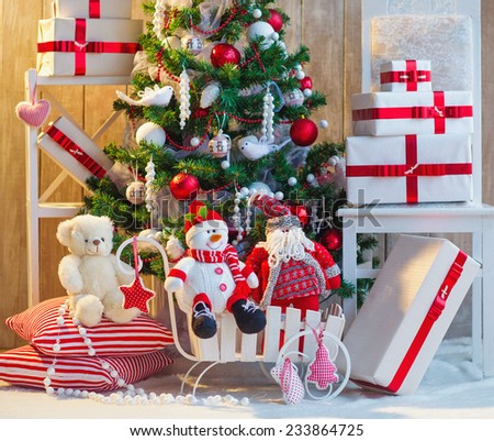 Christmas tree decoration with gift boxes and toys under it