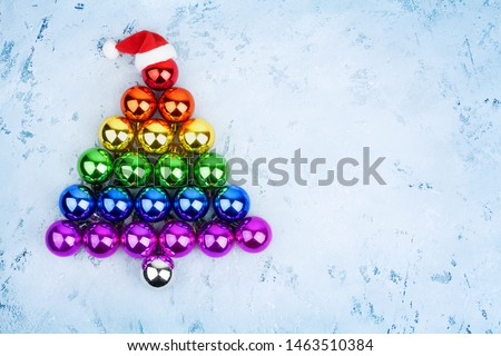 Christmas tree decorations glass balls LGBTQ community rainbow flag colors, Santa Claus hat, LGBT pride symbol, New Year holiday greeting card design, lesbian and gay xmas night party sign, copy space