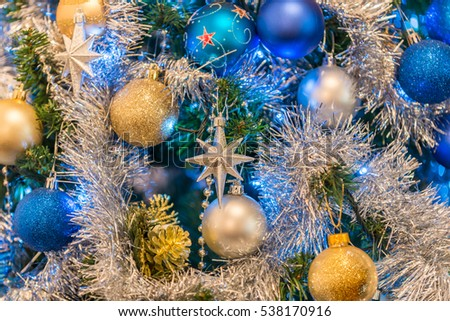 christmas tree decorations including a silver star bluesilver and gold baubles and tinsel - Blue And Gold Christmas Tree Decorations
