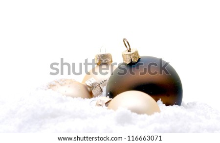 christmas tree decorations lying in the snow