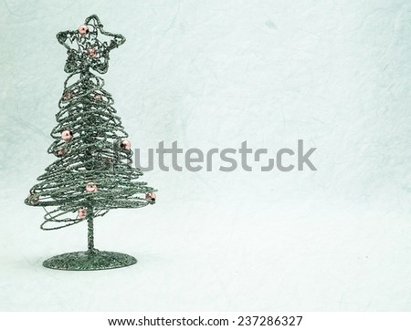 Christmas Tree decorations on mulberry paper texture for background