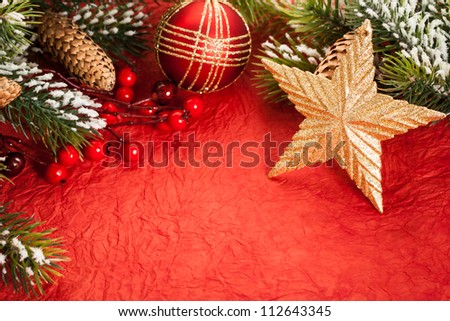 Christmas tree decorations on red paper