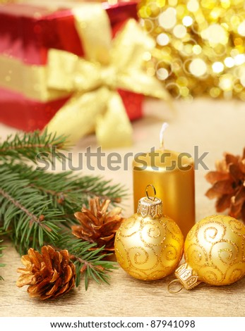 Christmas tree decorations with gift box on gold background