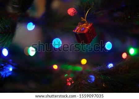 Christmas tree gift ornament with defocused lights background #1559097035