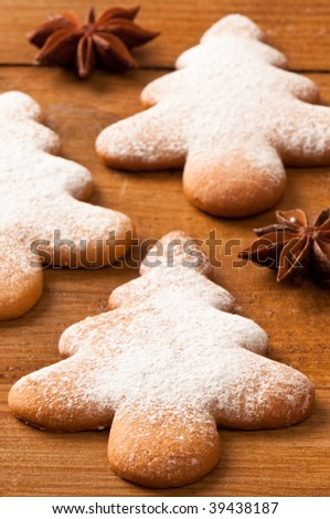 Christmas tree gingerbread cookies dusted with icing sugar