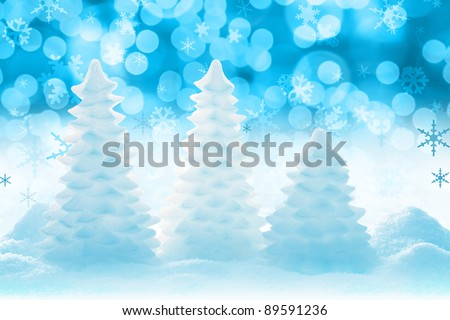 Christmas tree ice sculptures with bokeh background. - stock photo