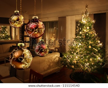 Christmas tree lights reflecting from glass balls and mirror - stock photo