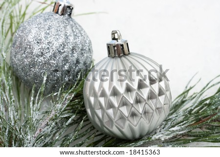 Christmas tree limb with silver glass ornaments on white background, Christmas border