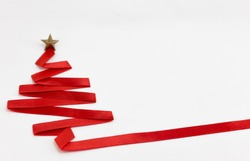 christmas tree made from ribbon on white background. christmas day concept.