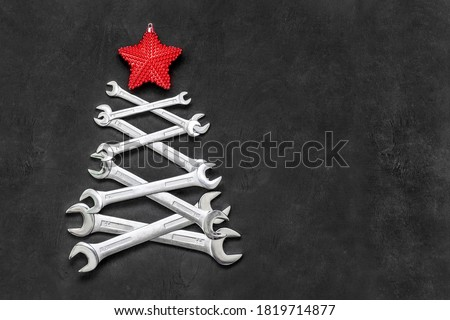 Christmas tree made from steel tools. Happy new year and merry christmas holiday. Copy space