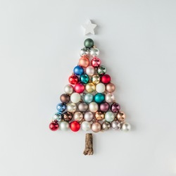 Christmas tree made of bauble decoration. Minimal New year concept.