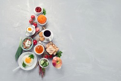 Christmas tree made of breakfast menu on light grey background. Top view, Copy space