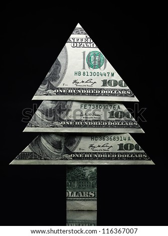 Christmas tree made �¢??�¢??of one hundred dollar bills