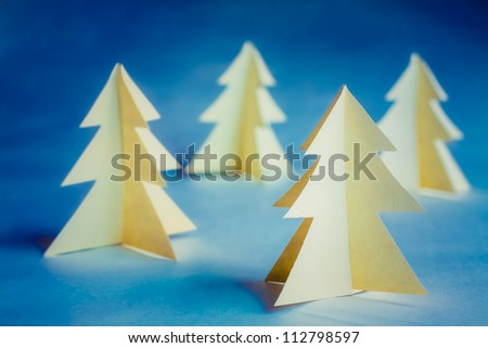 Christmas tree made of paper. Christmas card.