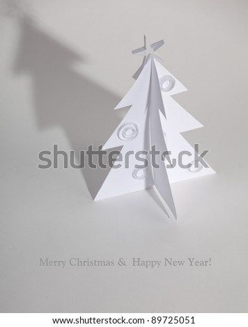 Christmas tree made ??of paper. Christmas card.