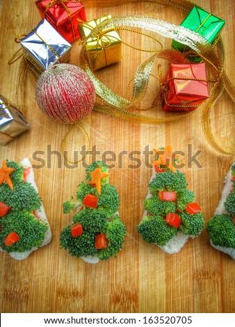 Christmas tree of bread  broccoli and tomatoes for christmas food
