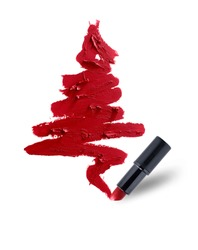 Christmas tree of red lipstick smeared. Beauty cosmetic creative concept