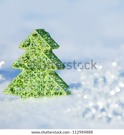 Christmas tree on snow. Winters background. Christmas card.