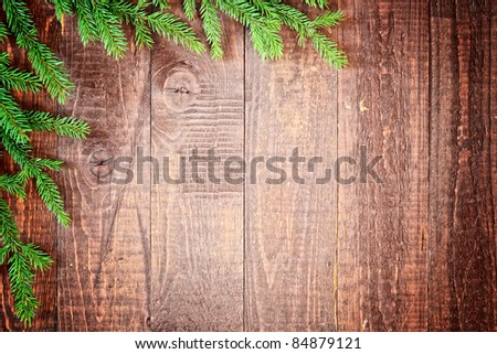 christmas tree on the old wooden background