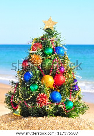 Christmas tree on the sand in the beach