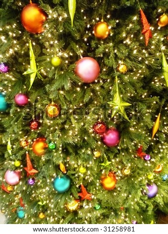 Christmas tree ornaments on Christmas tree, closeup - stock photo