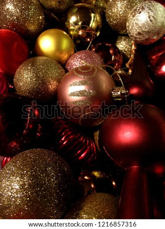 Christmas tree ornaments. Red, gold and pink balls with lot of shining and glitter.