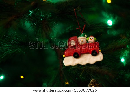 Christmas tree snowman ornament with defocused lights background #1559097026