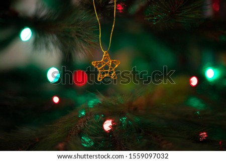Christmas tree star ornament with defocused lights background #1559097032