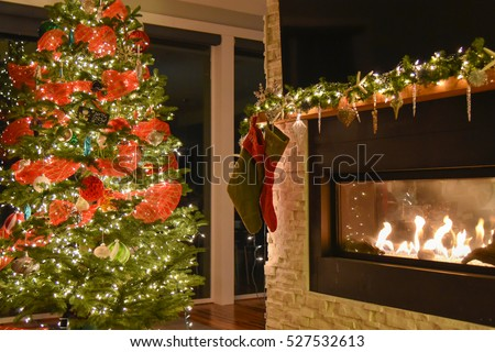 Christmas tree, stockings hung on the mantle over the fireplace.