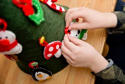 Christmas tree toy handmade from felt. Ergo therapy task for education. Fine motor skills for kids and disabled. Montessori methodology. Development, education. Activities at home.