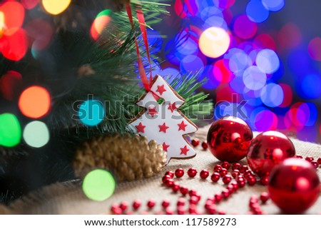 Christmas tree with bauble and cake over bright festive background