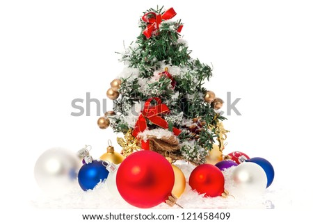 Christmas tree with baubles and snow isolated on white/Christmas tree and baubles