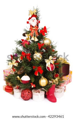 Christmas tree with baubles, balls and bows ornaments and gifts. A lovely traditional Christmas tree decorated in red and gold color.