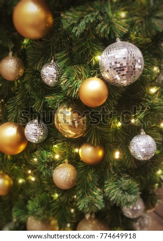Christmas tree with beautiful ans shiny ball ornaments - Shutterstock ID 774649918