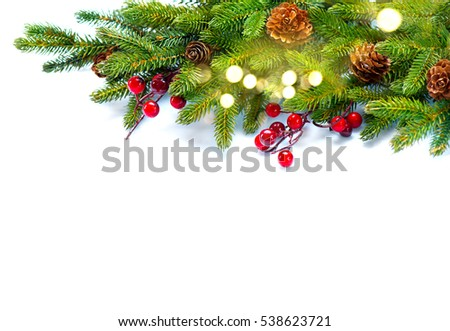 Christmas Tree with Cones border isolated on a White background. New Year holiday evergreen tree, Xmas green art corner design. Branches of fir tree decorated with holly berry, cone, light garland. #538623721