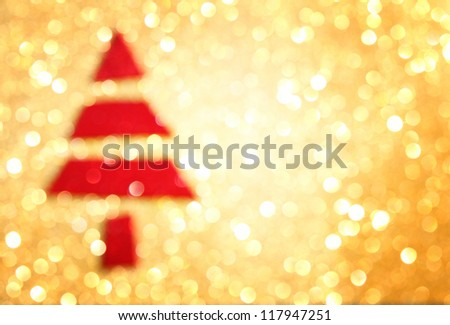 Christmas tree with defocused lights. golden background with copy space