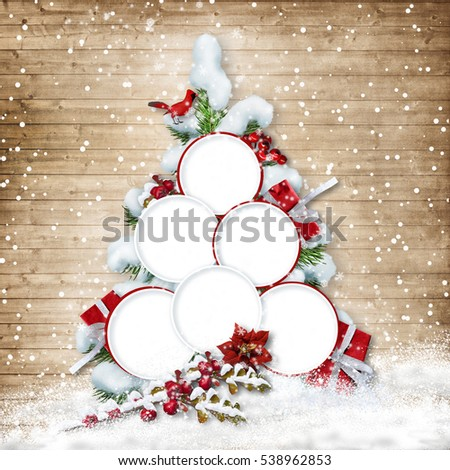 Christmas tree with frames for family photos on wooden background