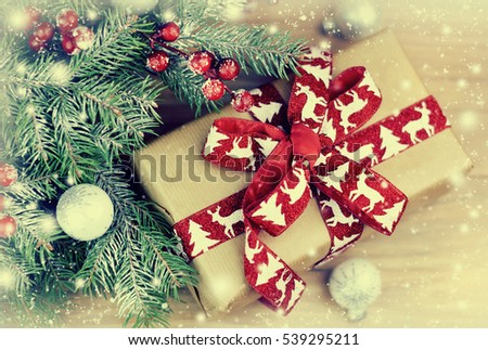 Christmas tree with gift box and decorations on wooden background #539295211