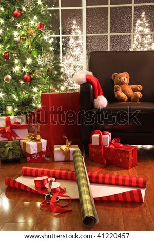 Christmas tree with gifts and teddy bear on chair