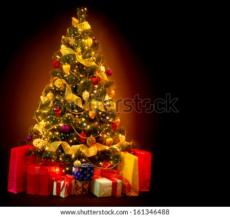 Christmas Tree with Gifts isolated on black background. Beautiful Decorated Christmas Tree with Baubles and Garland #161346488