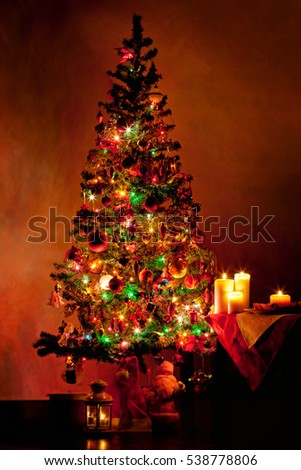 Christmas tree with light decorative garland in dark living room, greeting card with copyspace #538778806