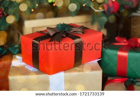 christmas tree with presents,red and green box with brown ribbons.