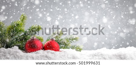 Christmas tree with red balls on snow