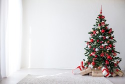 Christmas tree with red decorations new year gifts