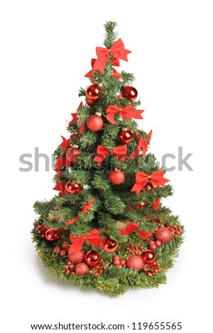 Christmas tree with red ornaments isolated on white